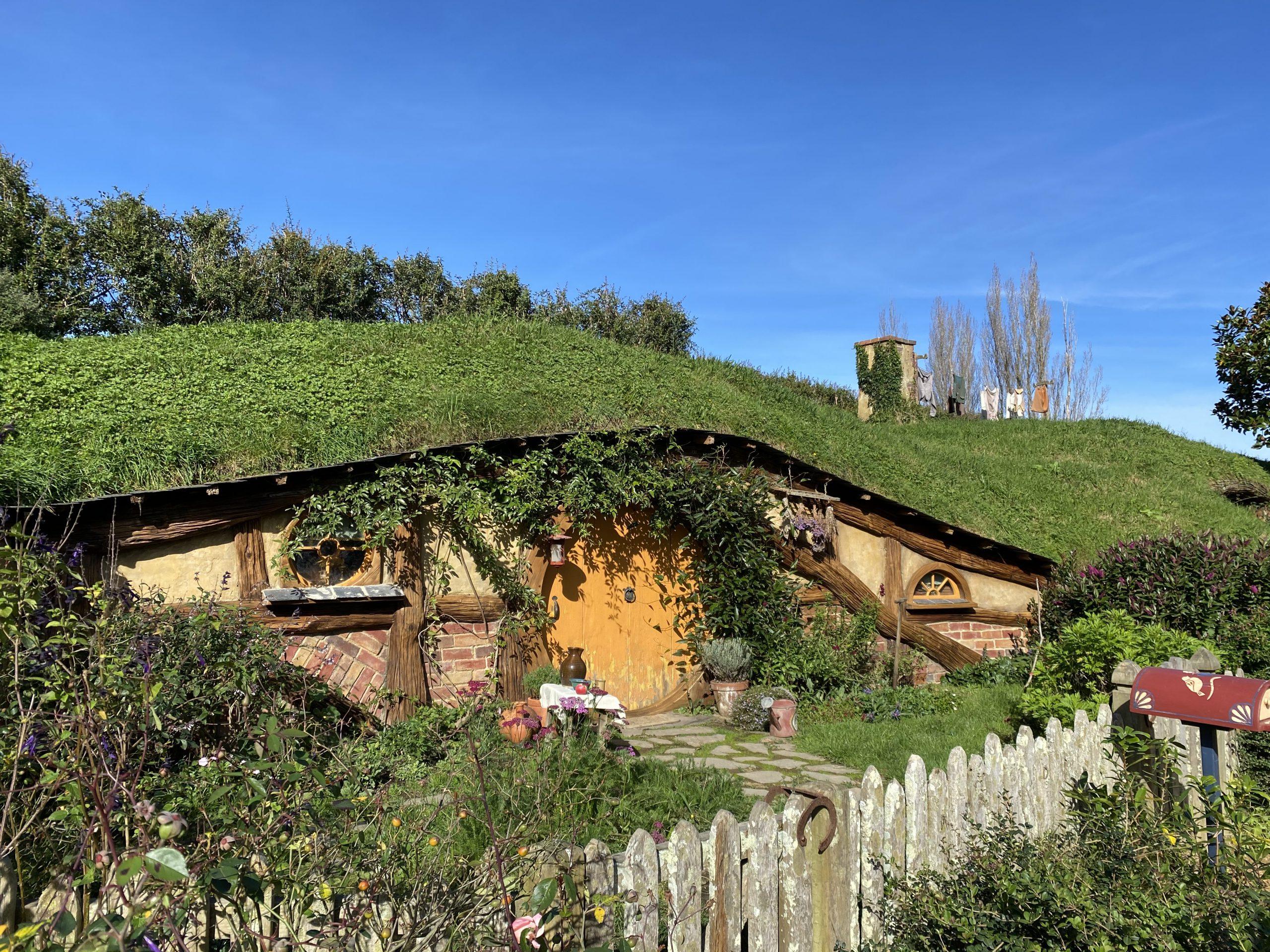 Hobbit hole with yellow door at Hobbiton Movie Set, New Zealand